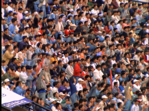 high angle of asian crowd cheering in baseball stadium / seoul - 1997 stock videos & royalty-free footage