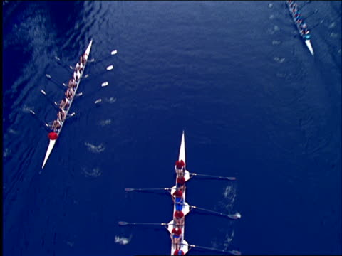 high angle of crew boats racing on river