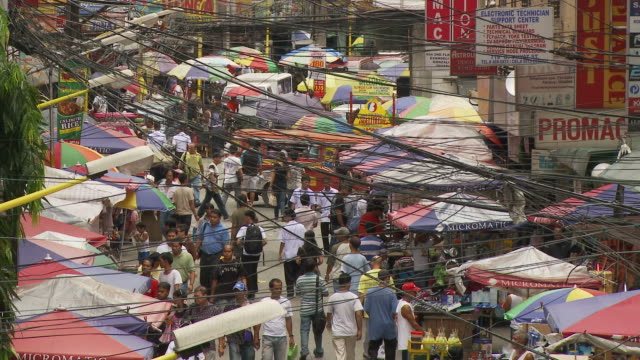 high angle of crowded street in downtown manila philippines - manila philippines stock videos and b-roll footage