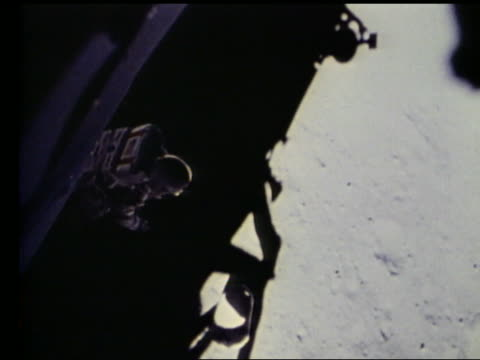 high angle of John Young stepping off lunar lander onto Moon