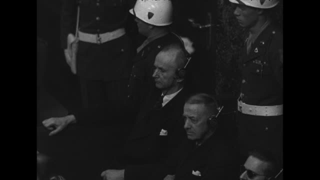 ms high angle of nazi youth leader baldur von schirach and nazi forced labor director fritz sauckel listening thru headphone translators at nuremberg... - war crimes trial stock videos and b-roll footage