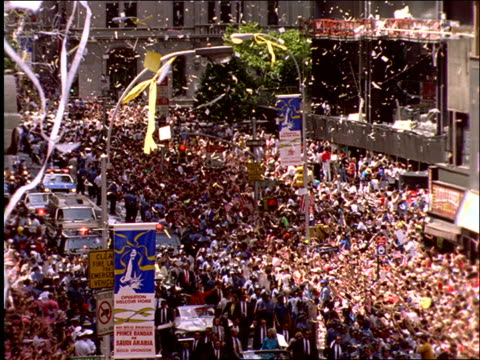 high angle of people in audience and ticker tape parade / operation welcome home / nyc - ticker tape stock videos and b-roll footage