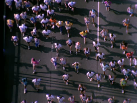 high angle of people running in marathon - marathon stock videos and b-roll footage