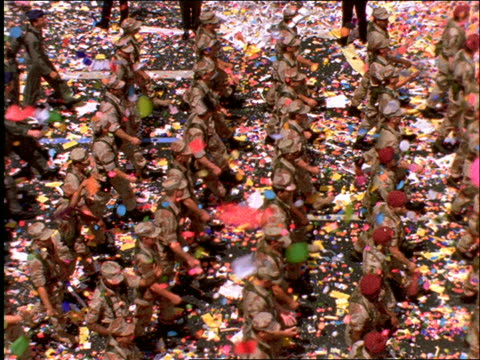 high angle of soldiers marching in ticker tape parade / Operation Welcome Home / NYC
