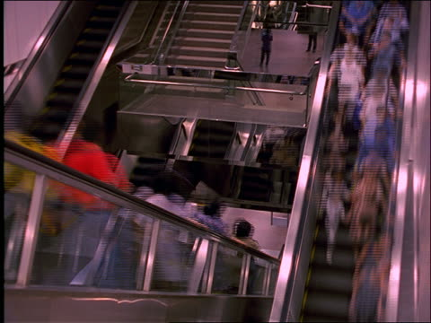 high angle of time lapse Asian people on escalator + stairs in subway station / Singapore Mass Rapid Transit (MRT)