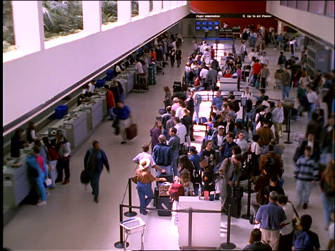 vídeos de stock e filmes b-roll de high angle of time lapse people in busy airport / los angeles - 1997