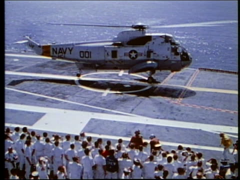 high angle of us navy helicopter landing on aircraft carrier / apollo 17 - splashdown stock videos and b-roll footage