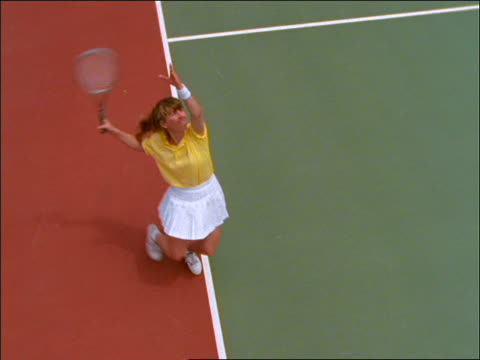high angle of woman serving ball in tennis match - serving sport stock videos and b-roll footage