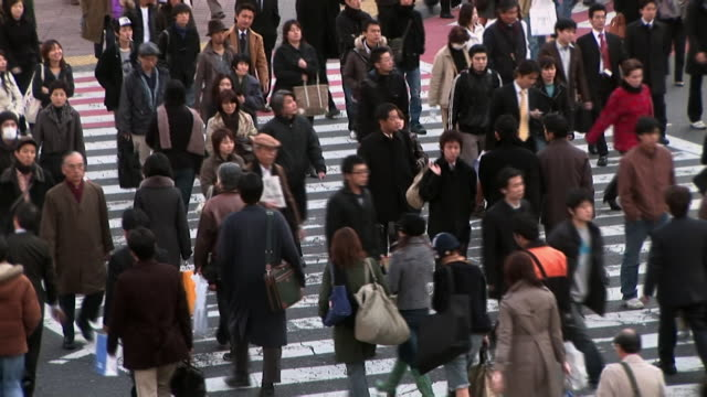 High angle over busy pedestrian crossing in Shibuya / Tokyo