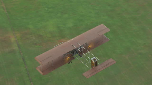 ws ts aerial high angle over wright b flyer airplane and airplane over huffman prairie / ohio, united states - wright flyer stock-videos und b-roll-filmmaterial