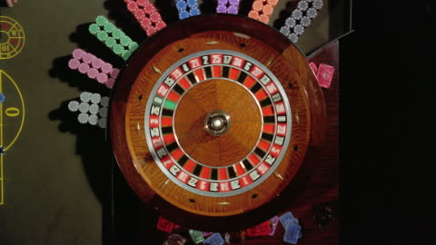high angle overhead view of roulette wheel spinning - spinning stock videos & royalty-free footage