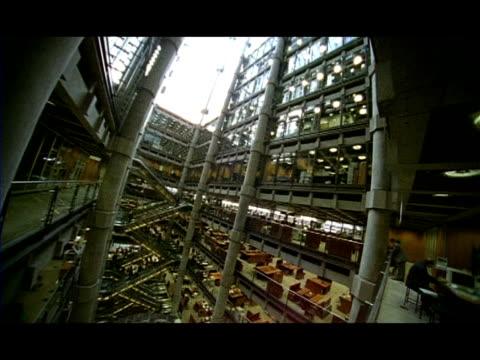 WA High angle pan left across interior of Lloyds Building, London, England