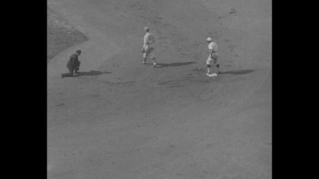 high angle pan of field at sportsman's park in st louis as the star spangled banner is played crowd cheers / first hit single / batter hits runs... - home run stock-videos und b-roll-filmmaterial