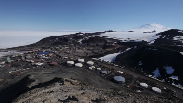 high angle pan over mcmurdo base, mcmurdo base, ross island, antarctica  - antarctica research stock videos & royalty-free footage