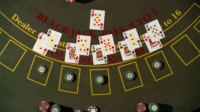 high angle pan overhead view of blackjack table / dealer dealing cards / paying winners - blackjack video stock e b–roll