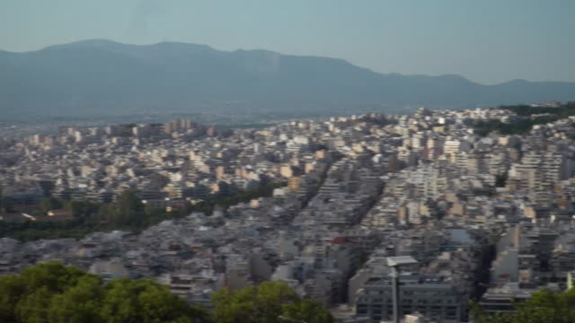 high angle pan shot across athens cityscape - greece stock videos & royalty-free footage