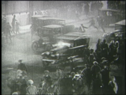 b/w 1925 high angle panicking crowds running + traffic in london street at night - 1925 stock videos & royalty-free footage
