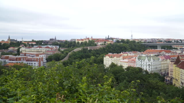 High angle panning view: Color old building among mountain range is belong Vyšehrad, Prague