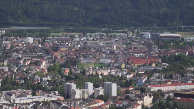 high angle panning  view of innsbruck city in afternoon summer - traditionally austrian stock videos & royalty-free footage