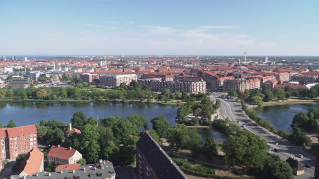 high angle panning view:amager east area of copenhagen city from view point on church of our saviour, denmark - copenhagen stock videos & royalty-free footage