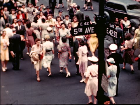 stockvideo's en b-roll-footage met 1945 high angle people crossing street at 5th ave. + 42nd st. / industrial - prelinger archief