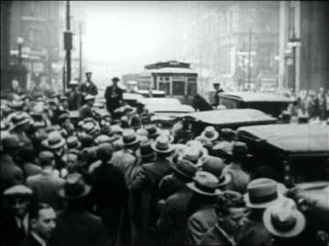 high angle people crowding around car on city street to see al capone - 1931 stock videos & royalty-free footage