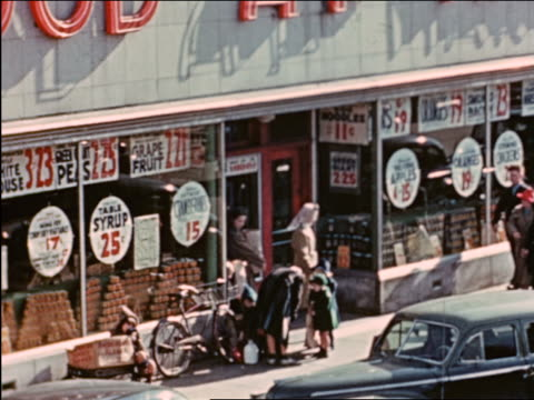 vidéos et rushes de 1941 high angle people exiting a and p grocery store / chicago / industrial - prelinger archive