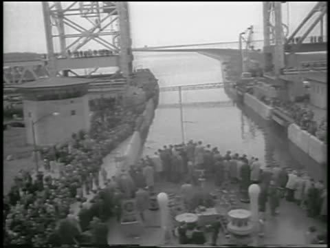 b/w 1959 high angle people on shore on ship going thru st lawrence seaway canal / canada / newsreel - 1959 stock videos & royalty-free footage