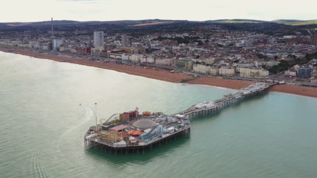 high angle perspective flying towards brighton coastline and the pier, england, united kingdom - coastal feature stock videos & royalty-free footage