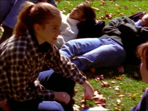 vidéos et rushes de high angle point of view students relaxing + talking on lawn on college campus / boston, ma - 1990 1999