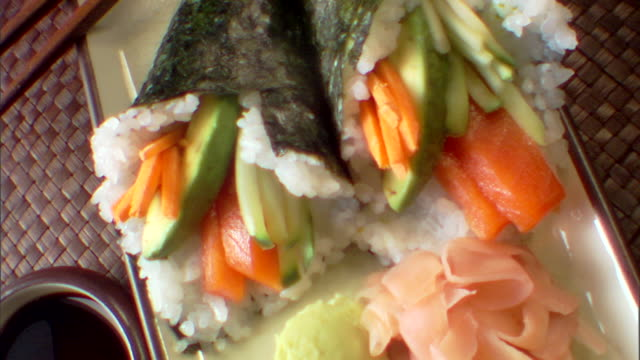 high angle pull out over a plate of cone sushi. - wasabi sauce stock videos and b-roll footage
