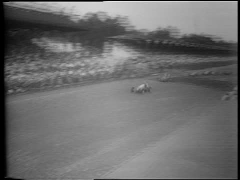 b/w 1953 high angle pan race cars speeding past camera past crowded bleachers / indianapolis 500 - 1953 stock videos and b-roll footage