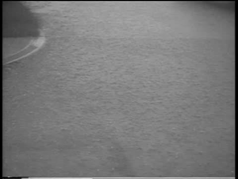 vídeos de stock, filmes e b-roll de high angle rain pounding on flooded street during hurricane / northeast us / newsreel - high street