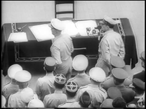 b/w 1945 high angle rear view admiral nimitz approaching table at surrender of japan on uss missouri - uss missouri stock videos and b-roll footage