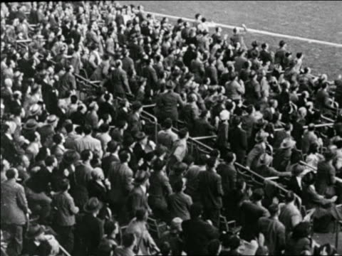 high angle rear view crowd rising to feet in yankees vs. dodgers game / world series - 1947 stock videos & royalty-free footage