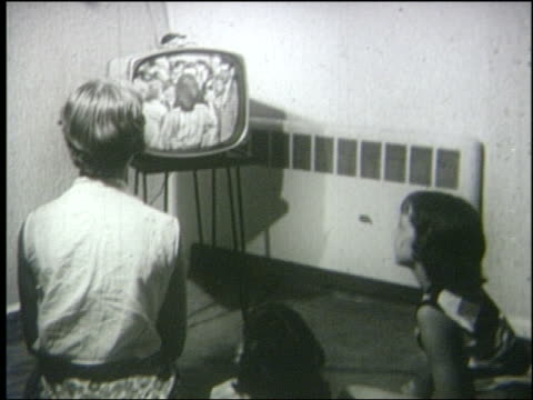 B/W 1950 high angle REAR VIEW over-the-shoulder woman + young girl watching couple dance on television