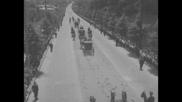 high angle rearview of horses and carriages in funeral cortege of empress teimei mother of japanese emperor hirohito procession moves along road... - hirohito stock videos & royalty-free footage