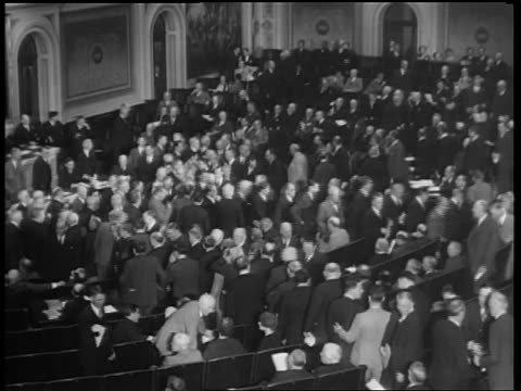 B/W 1933 high angle Representatives slowly exiting chamber / House of Reps repealing prohibition