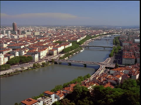 high angle Rhone River + bridges in city of Lyon / France