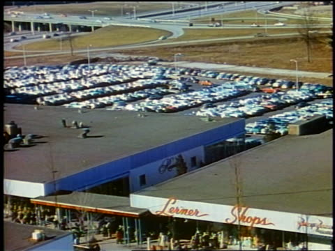 vídeos de stock, filmes e b-roll de 1958 high angle rooftop of busy shopping mall + crowded parking lot / newsreel - 1958