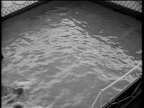 b/w 1934 high angle row of girls racing in swimming pool on ship deck / cruise ship - 1934 stock videos & royalty-free footage