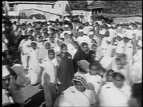 high angle rows of women in saris marching at anti-british rule demonstration / bombay, india - 1930 stock videos & royalty-free footage