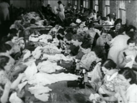 B/W 1934 high angle rows of women using sewing machines in WPA garment factory / documentary