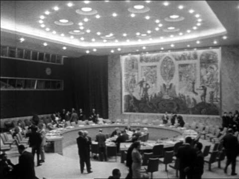 B/W 1967 high angle Security Council meeting at round table in United Nations / New York City / newsreel