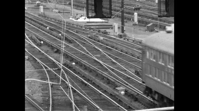 high angle sequence of long island trains moving past camera - long island railroad stock videos and b-roll footage