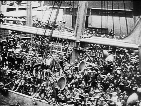 b/w 1917 high angle ship with crowd of soldiers on deck waving as it pulls out of harbor / ww i / documentary - 1917 stock videos & royalty-free footage