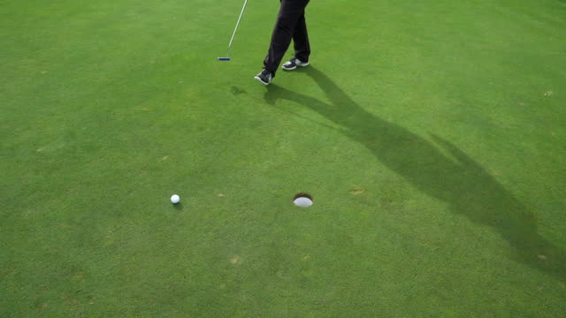 high angle short putting in the hole. - sun visor stock videos & royalty-free footage