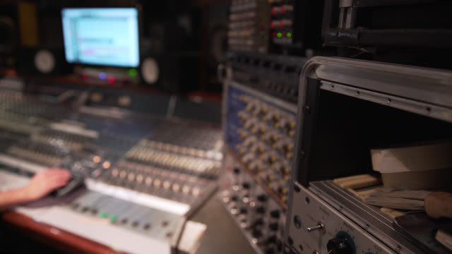 high angle shot of a mixing desk out of focus in the background - keypad stock videos & royalty-free footage