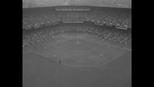 high angle shot of action on the field during 1952 world series game between brooklyn dodgers and new york yankees / exterior of ebbets field / high... - frivarv bildbanksvideor och videomaterial från bakom kulisserna