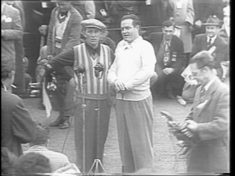 high angle shot of bob hope amongst the crowd and waving and walking down the green / wide shot of bob hope sinking a put on the final green and... - bob hope komiker stock-videos und b-roll-filmmaterial
